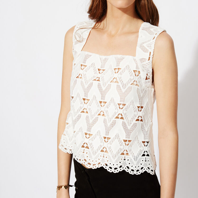Sleeveless lace top : Features color