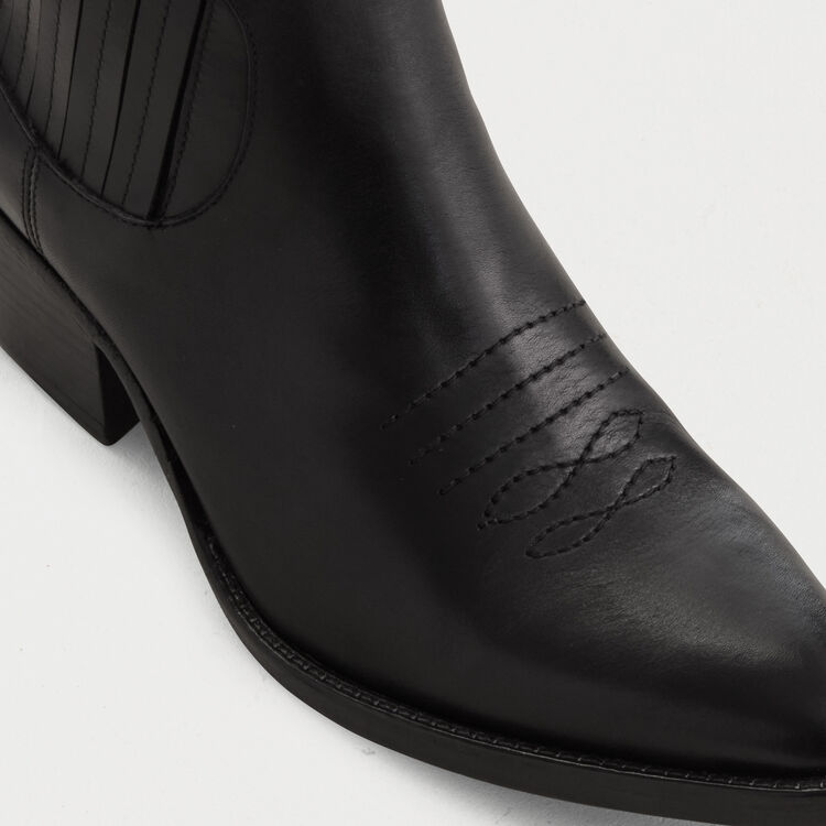 Leather cowboy boots : Shoes color Black