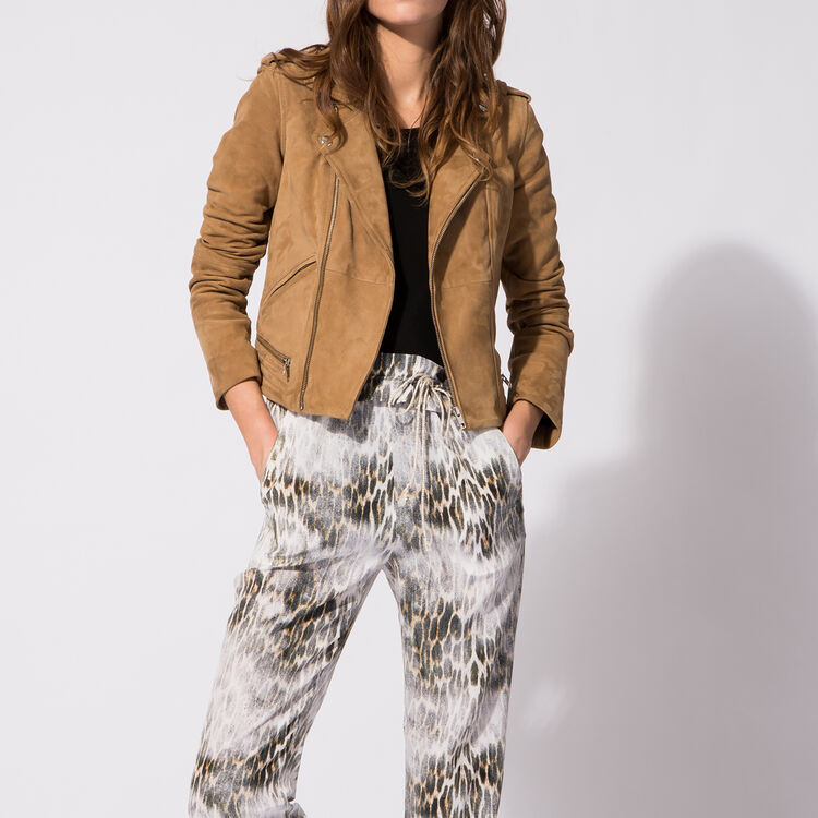 Leopard-print silk trousers : An invitation to travel color