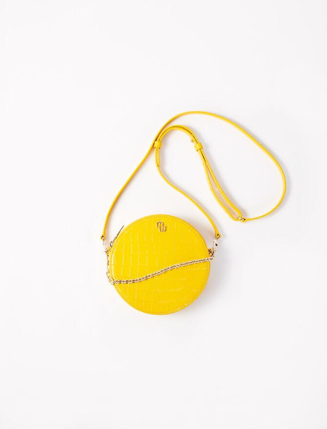 Round embossed leather handbag -  - MAJE