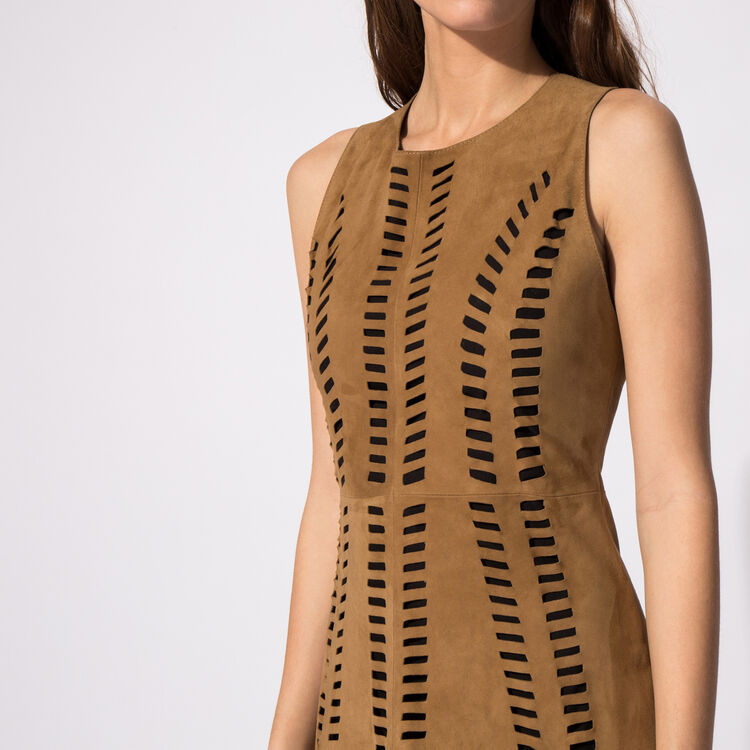 Perforated leather dress : An invitation to travel color